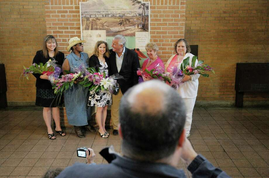 Albany Mayor Jerry Jennings, center, poses for a photograph with  Mother of the Year finalists, from left, Heather Corey-Mongue of Glenmont, Gwenndolynn Thompson-Chappell of Albany,  Christy Bunkoff of Watervliet, Barbara Quinn of Delmar and Charlene Dobert of Troy during the Albany Tulip Festival at Washington Park on Sunday, May 12, 2013 in Albany, NY.  Bunkoff was crowned  Mother of the Year.  Bunkoff has three children, two boys and a girl between the ages of nine and twelve.  (Paul Buckowski / Times Union) Photo: Paul Buckowski