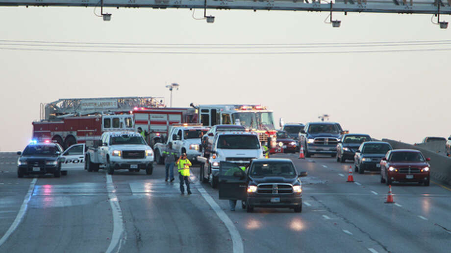 A four-vehicle wreck jams inbound Interstate 45 near the 610 Loop early Monday morning. Photo: (Mayra Beltran / Houston Chronicle)