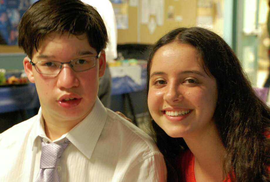 Renee Reiner, 16, and Austin Brouillet, 17, enjoyed the Best Buddies' ball at Staples High School on Saturday.   WESTPORT NEWS, CT 5/11/13 Photo: Jarret Liotta / Westport News contributed