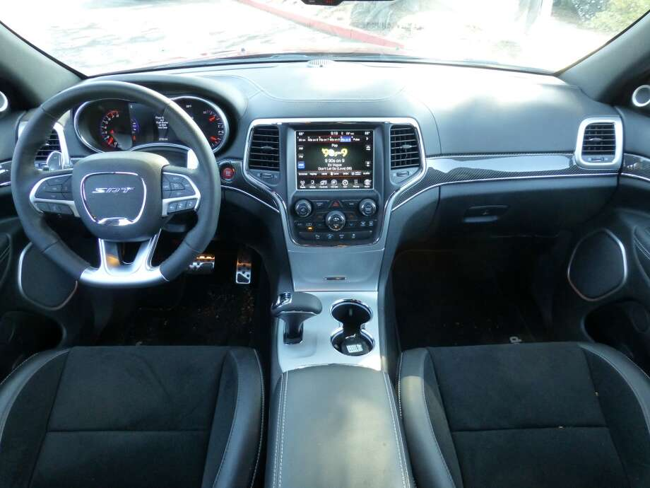 The cockpit is typified by a strong, thick steering wheel and no-nonsense paddle shifters.