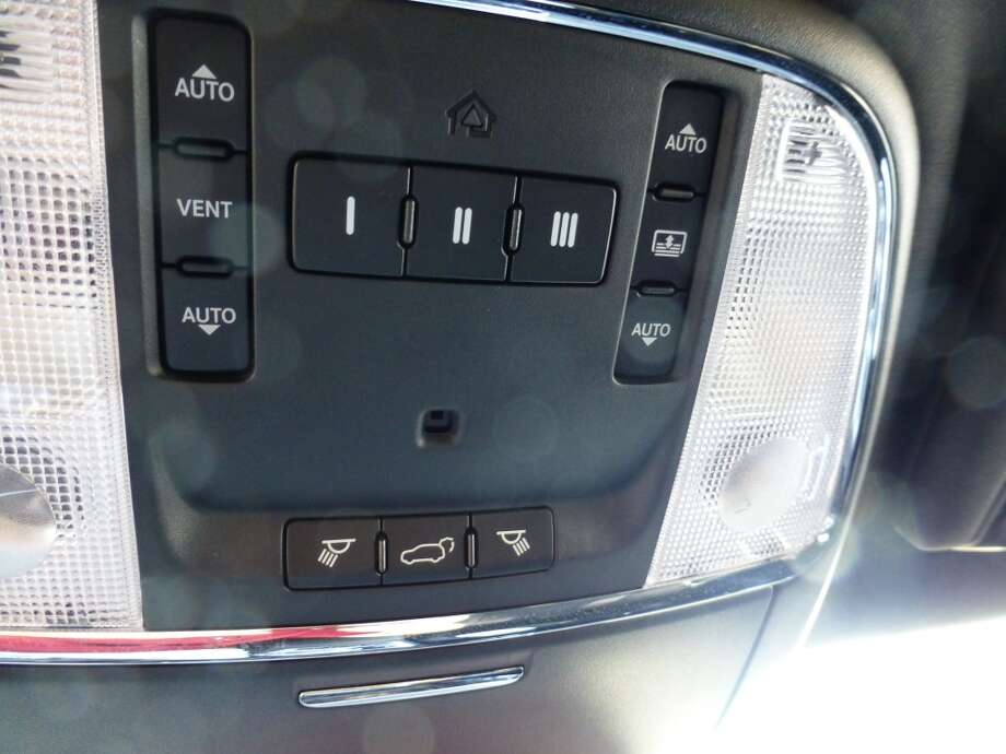 Notice the tiny tailgate release button in the middle of a welter of switches. Not easy to find, at first.