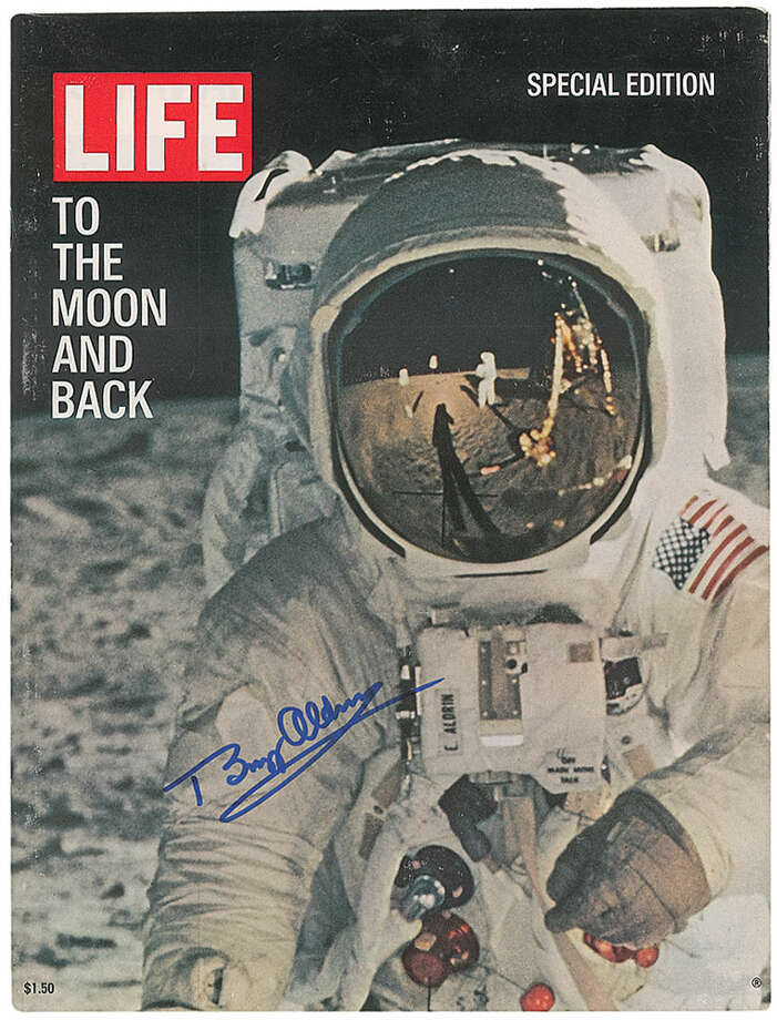 Special edition of Life magazine from 1969 commemorating the Apollo 11 moon landing, featuring an image of Aldrin on the cover, 10.25 x 13.75, signed on the front cover in blue felt tip.