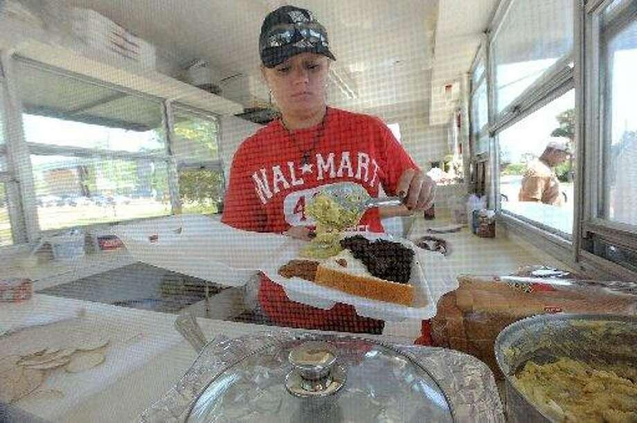 Karla Harrington prepares a sliced brisket plate at Wise Guys Grill