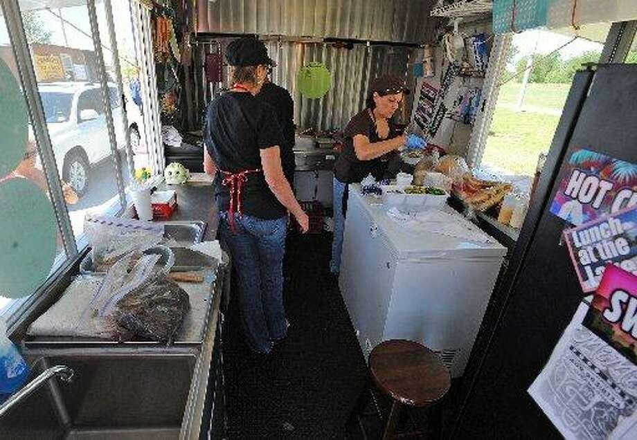 Employees prepare a Been Bowl Mi Mi's Food Hut