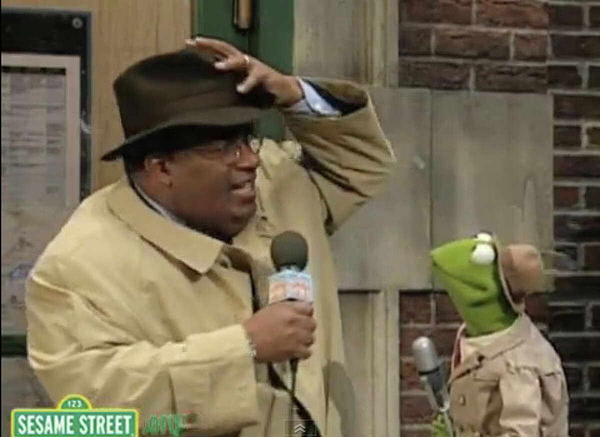 Kermit the Frog is pictured with Al Roker in this scene from