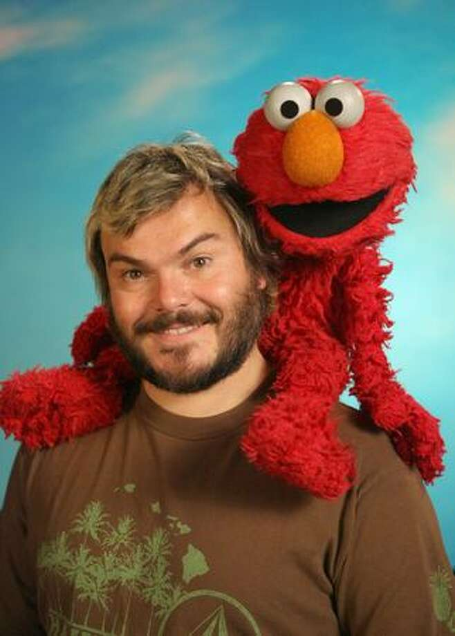 Elmo made his main-character debut in 1984, with a distinctive falsetto and habit of speaking in the third person. His popularity soon overshadowed fellow Muppets , in part due to the '90s toy, ''Tickle Me Elmo.'' Elmo is pictured with Jack Black. Photo: File Photo / PBS