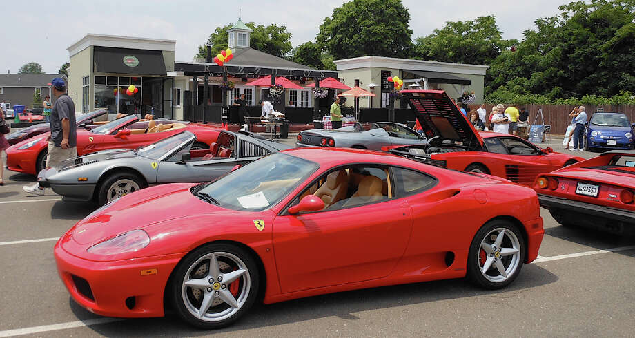 Ferraris and other classic Italian cars gleam under the sun outside of Rizzuto's Restaurant & Bar last year during the third annual Mille Ferrari car show. The eatery plans on hosting the event for the fourth consecutive year on Sunday, June 9. Photo: File Photo , File Photo / Westport News contributed