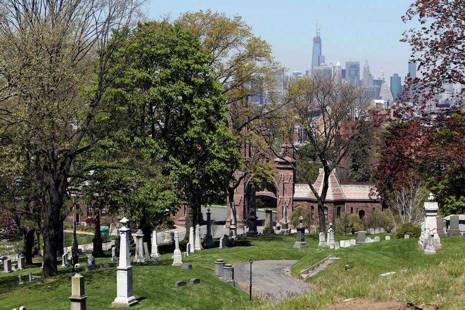 This May 2, 2013 photo shows the view of Manhattan from Brooklyn's Green-Wood Cemetery in New York. The 478-acre site is celebrating its 175th anniversary this year and a special exhibition on Green-Wood is opening at the City Museum of New York.  While it cannot replace a visit to the cemetery grounds, it provides a historical context for one of only four U.S. cemeteries to be granted National Historic Landmark status. Photo: Mary Altaffer, AP / AP
