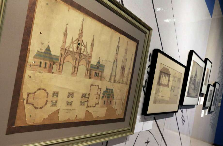 "Architectural drawings of New York's Green-Wood Cemetery, showing the venue's Gothic Revival style, is displayed at the Museum of the City of New York,  part of the ""A Beautiful Way To Go: New York's Green-Wood Cemetery,"" exhibit Thursday, May 9, 2013. Photo: Richard Drew, AP / AP"