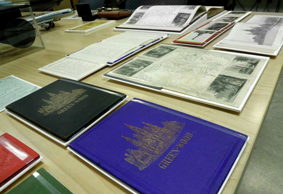 "Antique guide books for New York's Green-Wood Cemetery are displayed before installation in the ""A Beautiful Way To Go: New York's Green-Wood Cemetery"" exhibit, at the Museum of the City of New York, Thursday, May 9, 2013. Photo: Richard Drew, AP / AP"