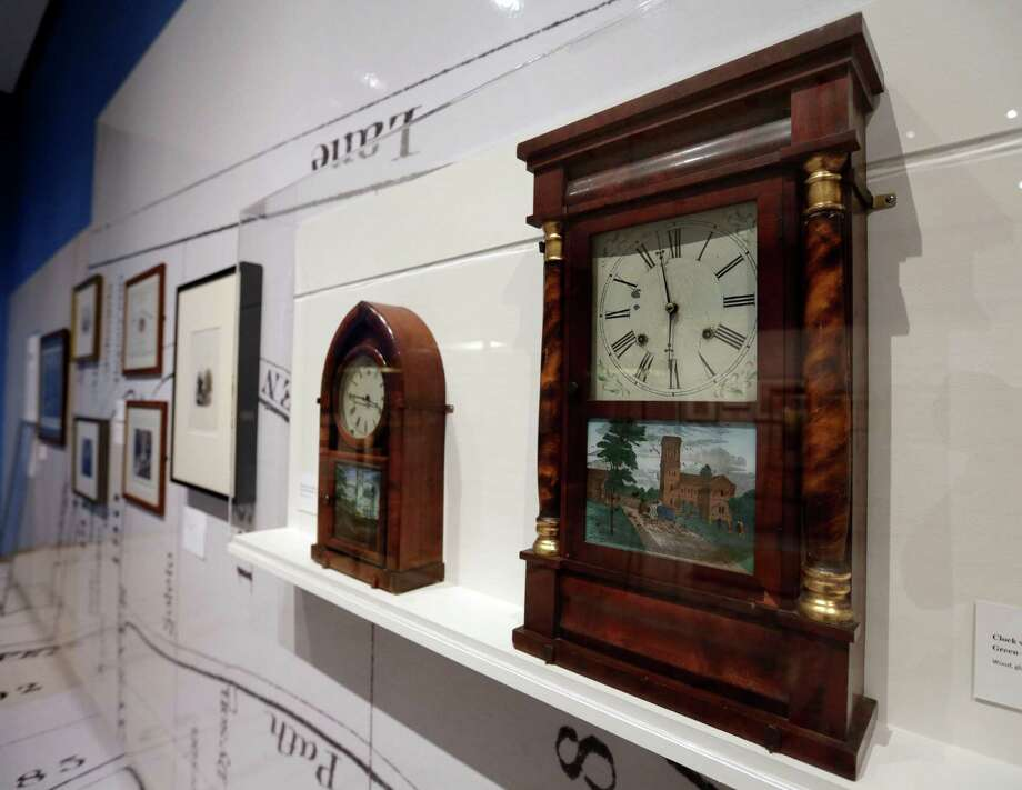 "Clocks showing views of the western entrance to New York's Green-Wood Cemetery are displayed at the Museum of the City of New York,  part of the ""A Beautiful Way To Go: New York's Green-Wood Cemetery,"" exhibit Thursday, May 9, 2013. Photo: Richard Drew, AP / AP"