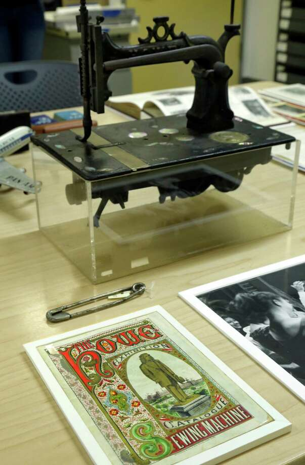 "A Howe sewing machine catalog cover and sewing machine, by Elias Howe, who is buried in New York's Green-Wood Cemetery, is displayed at the Museum of the City of New York, prior to its installation in the ""A Beautiful Way To Go: New York's Green-Wood Cemetery,""  exhibit, Thursday, May 9, 2013. Photo: Richard Drew, AP / AP"