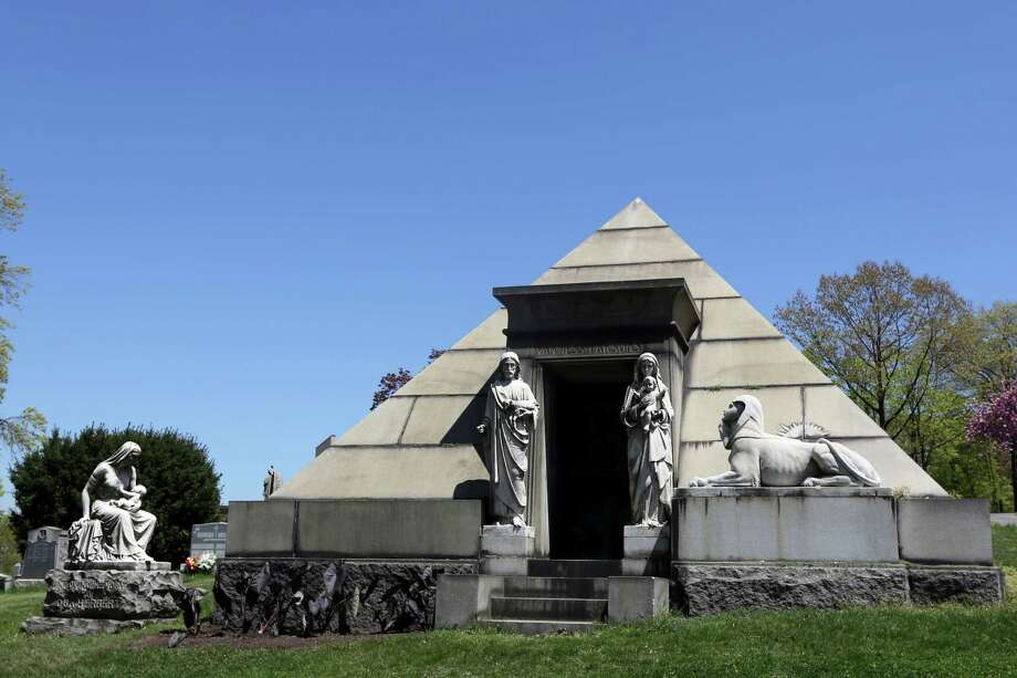 This May 2, 2013 photo shows a mausoleum fashioned after a pyramid at Brooklyn's Green-Wood Cemetery in New York. The 478-acre site is celebrating its 175th anniversary this year and a special exhibition on Green-Wood is opening at the City Museum of New York.  While it cannot replace a visit to the cemetery grounds, it provides a historical context for one of only four U.S. cemeteries to be granted National Historic Landmark status. Photo: Mary Altaffer, AP / AP