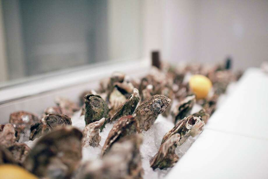 Fresh oysters in ice are displayed in the raw bar at Brasserie 19. Photo: TODD SPOTH, Freelance / Todd Spoth