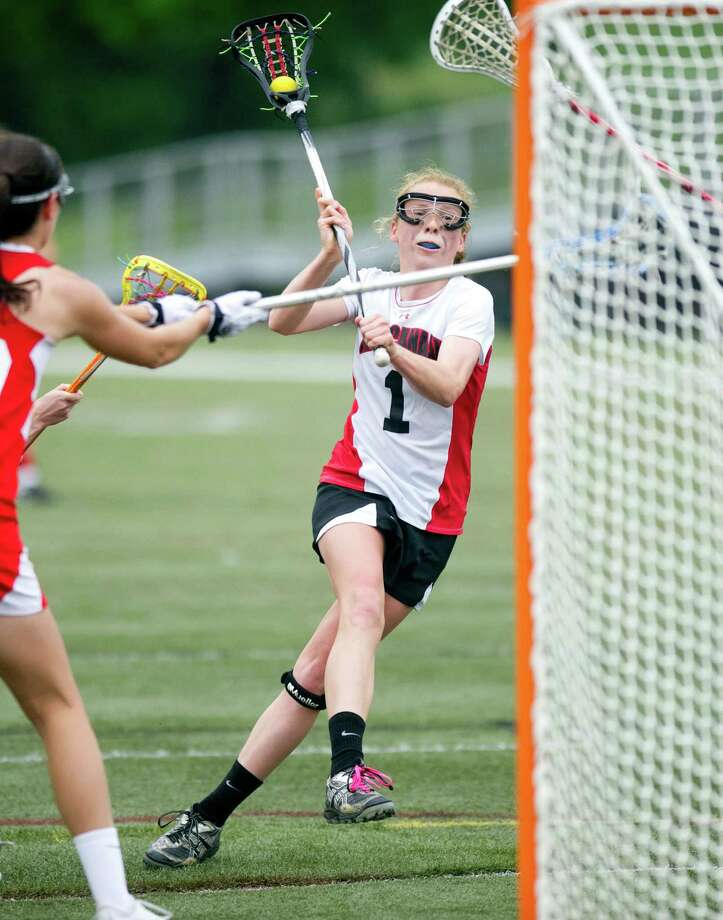 Elizabeth Miller scores a goal during Saturday's girls lacrosse game at New Canaan High School against Fox Lane on May 11, 2013. Photo: Lindsay Perry / Stamford Advocate
