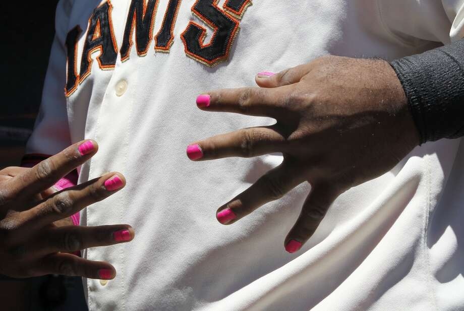 San Francisco Giants third baseman Pablo Sandoval shows his support with painted pick finger nail polish for Cancer Awareness Day.