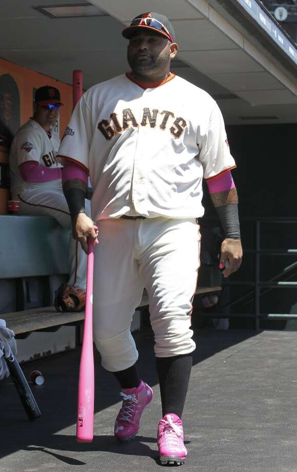 San Francisco Giants third baseman Pablo Sandoval (48) shows his support with pick shoes and bat for Cancer Awareness Day against the Atlanta Braves in a baseball game in San Francisco, Sunday, May 12, 2013.