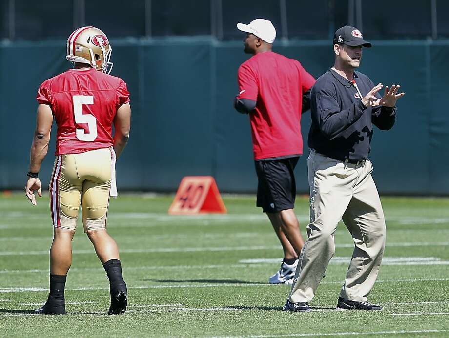 San Francisco 49ers coach Jim Harbaugh, right, works with rookie quarterback BJ Daniels (5) during practice at NFL football rookie camp at the team's training facility in Santa Clara, Calif., Friday, May 10, 2013. (AP Photo/Tony Avelar) Photo: Tony Avelar, Associated Press
