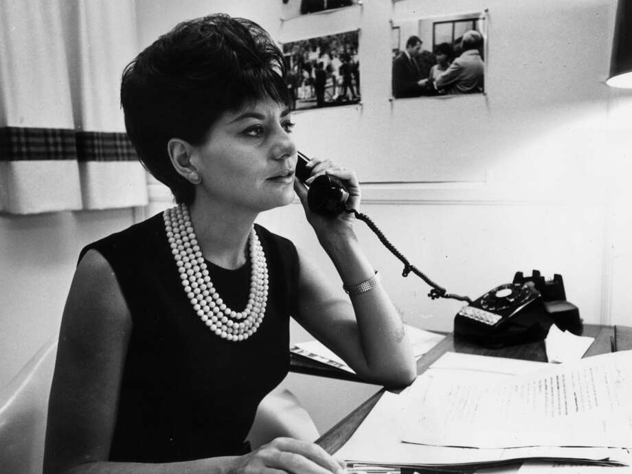 Television journalist for NBC Barbara Walters takes a phone call at her desk in New York City in 1964.