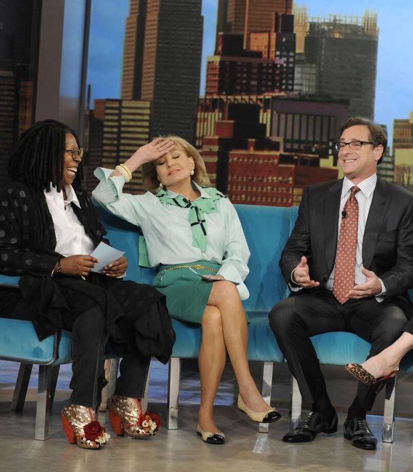 "Barbara Walters, center, with Whoopi Goldberg and Bob Saget on ""The View"" in 2013."