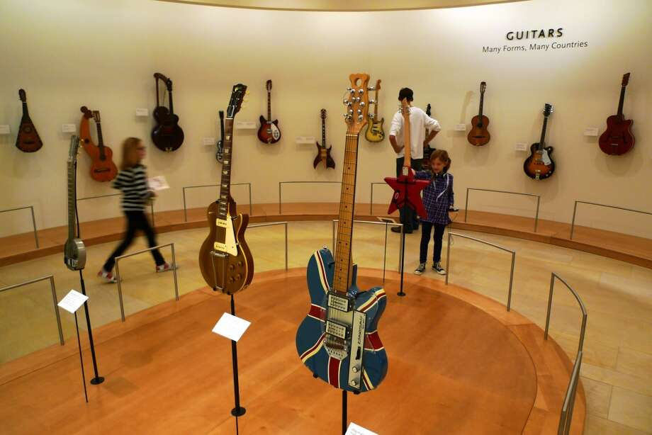 Display of guitars, including some from famous rockers.