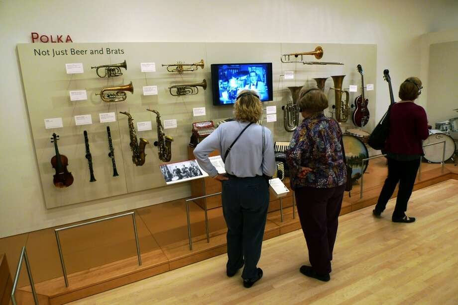 Visitors learn from a display on polka.