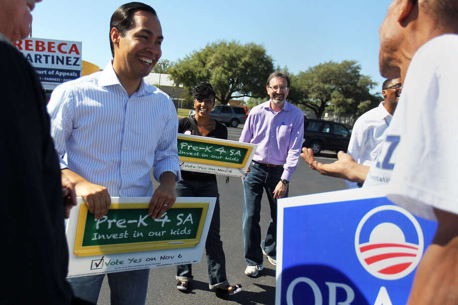 Mayor Julián Castro greets supporter David Drake as he campaigns for Pre-K for SA outside the Claude Black Center. Photo: Jennifer Whitney / For The Express-News