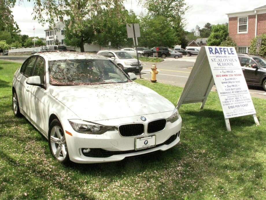 St. Aloysius Elementary School will raffle off this BMW 328i, currently parked on Cherry Street and South Avenue. May 13, 2013, New Canaan, CT. Photo: Tyler Woods