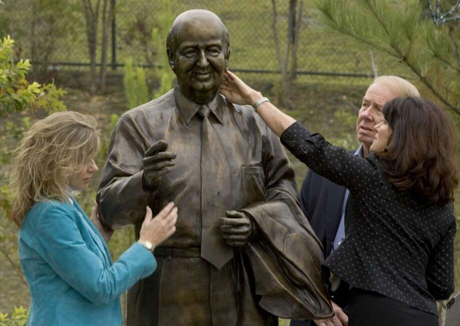 Sheridan Mitchell Lorenz, right, reaches up to touch the face of the sculpture of her father, The Woodlands founder George P. Mitchell, after it was unveiled at Town Green Park Thursday, Nov. 8, 2007, in The Woodlands, Texas. Lorenz stands with Carla Macaw, left, and Bill Kendrick. Photo: Brett Coomer, Houston Chronicle