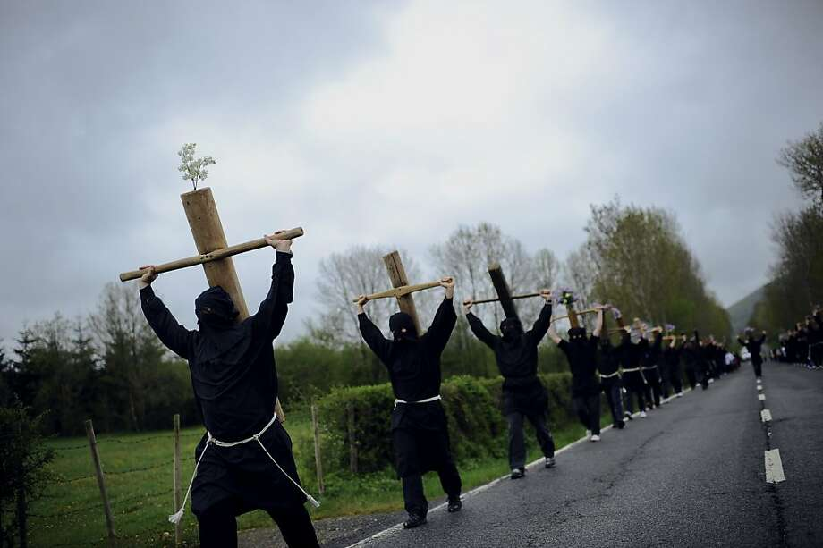 Crossing the road: Masked penitents march during the spring Romeria de Arce pilgrimage near Burguete, Spain. Photo: Alvaro Barrientos, Associated Press