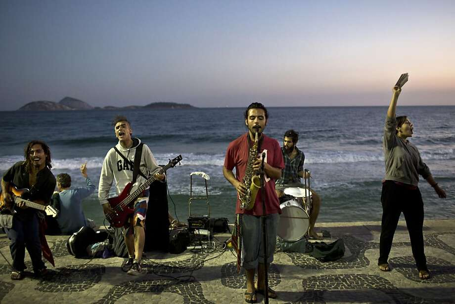 Sax on the beach: A band rocks the sunset at Ipanema beach in Rio de Janeiro. Photo: Felipe Dana, Associated Press
