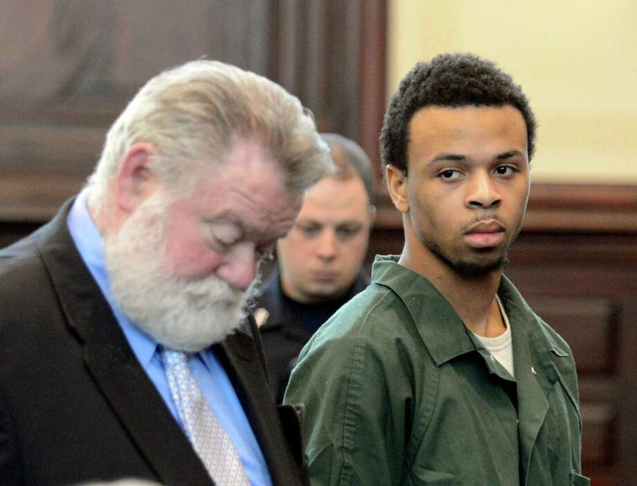 "Ravenal Gregory ""Kannons"" Dunbar appears in front of Judge Patrick McGrath with his attorney Robert Knightly, left, to take a plea in the murder case of Takim Smith May 13, 2013 in the Rensselear County Courthouse in Troy, N.Y.    (Skip Dickstein/Times Union) Photo: SKIP DICKSTEIN / 00022350A"