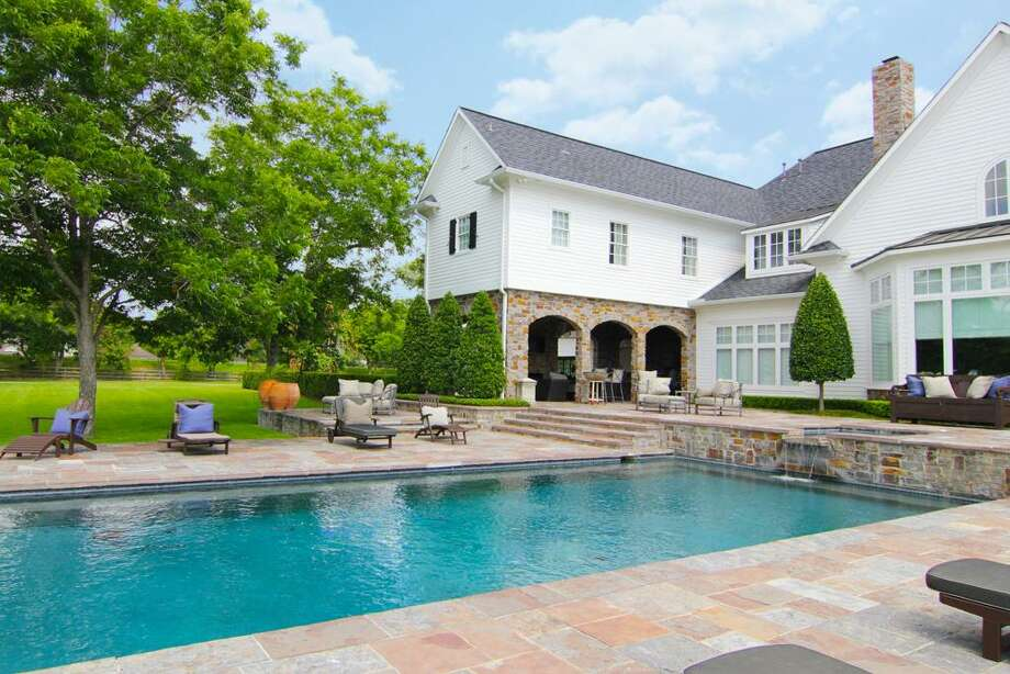 Another view of the pool with slate surrounds.See the listing hereorfind your next home here. Photo: HAR.com