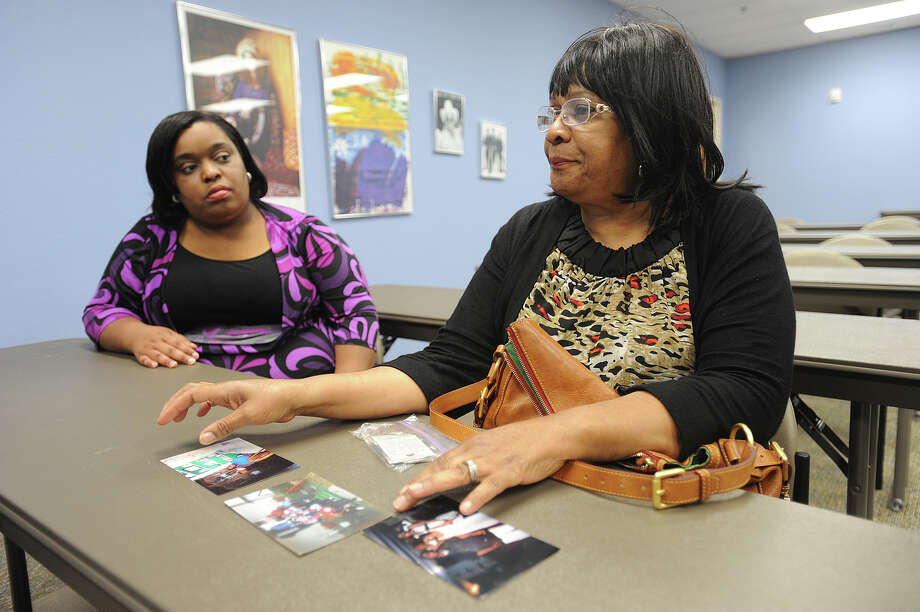 From right, Claudia Lincoln lines up photos Friday of her son Michael Gatlin who is a hit-and-run victim. Michael was struck by a suspected drunk driver whose legal case has been reset 26 times. Lola Gatlin, Michael's sister, is also pictured. Photo taken Friday, May 06, 2013 Guiseppe Barranco/The Enterprise Photo: Guiseppe Barranco, STAFF PHOTOGRAPHER / The Beaumont Enterprise