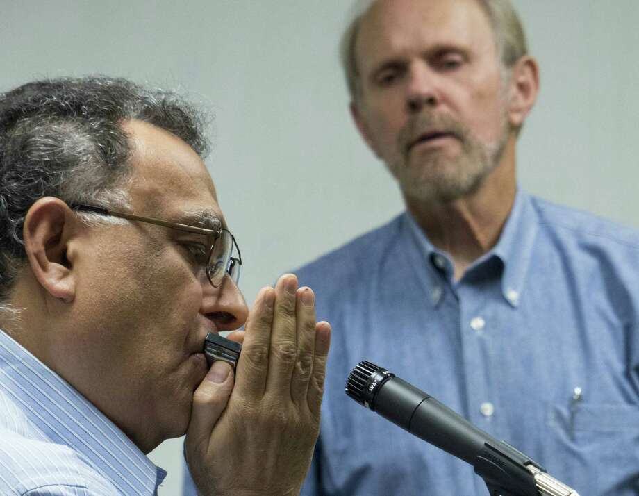 Harmonica teacher Don McRee watches as student Farhad Moshiri plays during a continuing education class at the North East ISD Community Learning Center. Photo: Billy Calzada / San Antonio Express-News