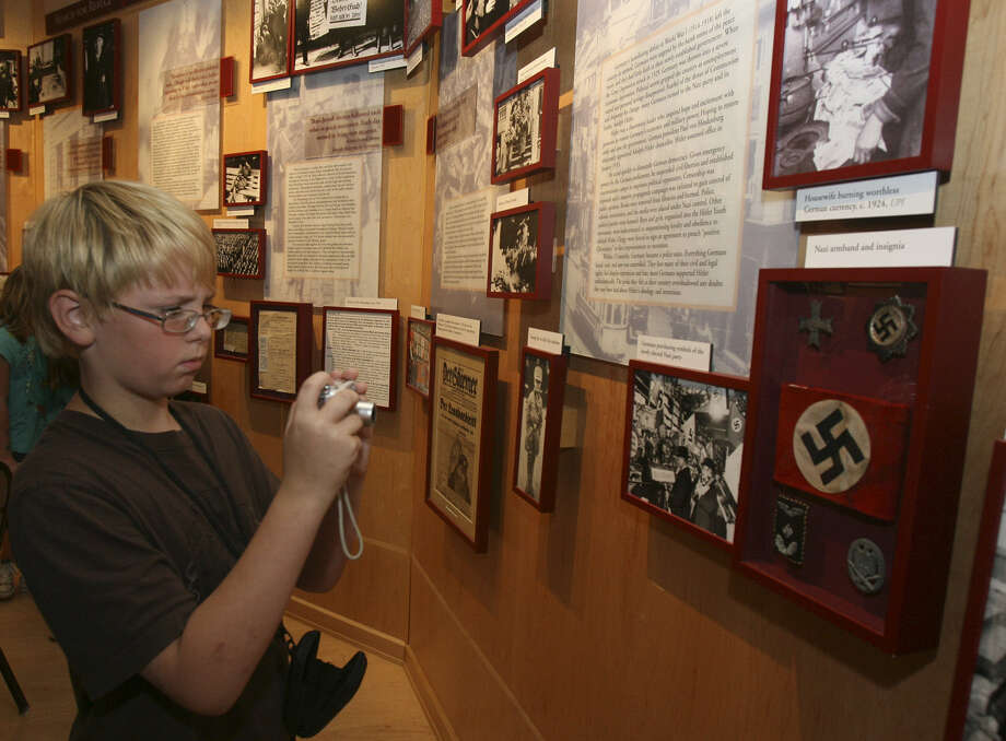 A visitor takes a photo of exhibits at the Holocaust Memorial Museum. It's one of a number of specialty museums in the San Antonio area. Photo: Express-News File Photo