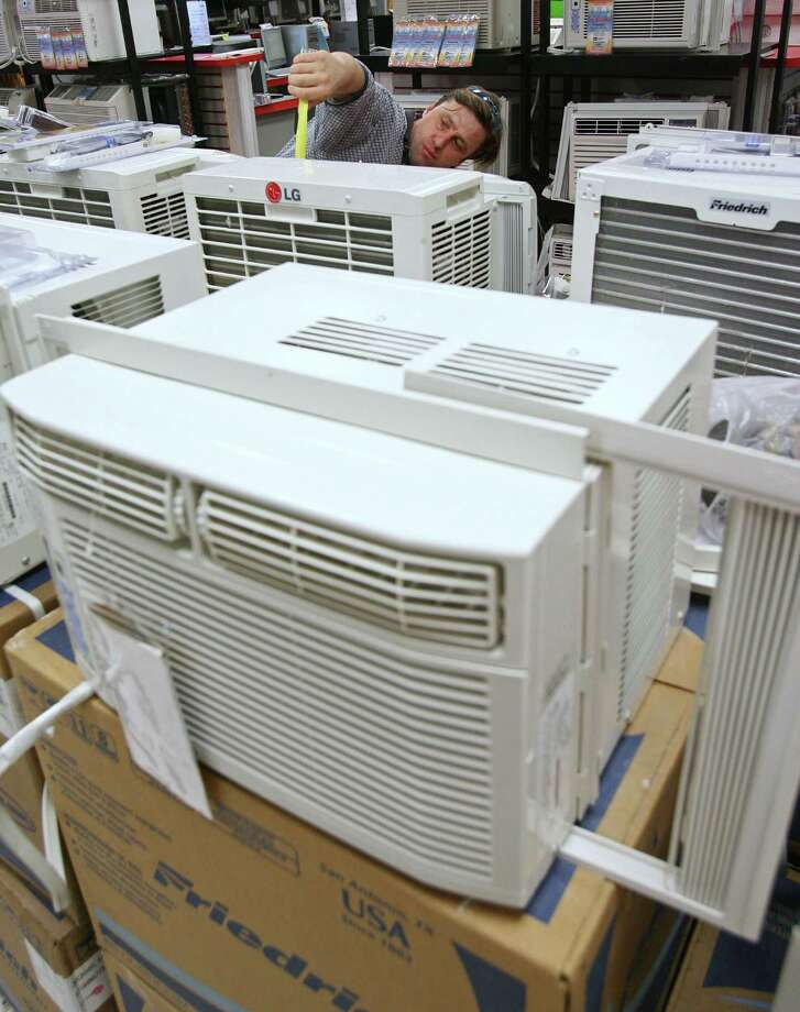 Choose a more energy-efficient air-conditioning unit. The higher the seasonal energy efficiency, or SEER, rating, the more efficient the unit. Look for a rating of 13 or greater. Photo: STEPHEN HILGER, BLOOMBERG NEWS