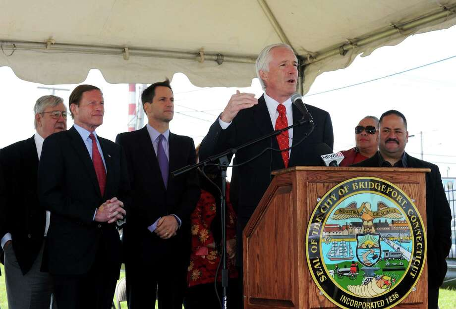 Mayor Bill Finch speaks to the crowd with Robert Christoph Sr., Senator Richard Blumenthal, Congressman Jim Himes, Concilwoman Evette Bratley and State Senator Andres Ayala behind him at the groundbreaking ceremony at the Steel Point peninsula in Bridgeport, Conn. on Monday May 13, 2013. An $11 million TIGER grant, will fund work that will create pedestrian and bike-friendly streets that connect neighborhoods to public transit, help open the Steel Point waterfront to development. Photo: Cathy Zuraw / Connecticut Post