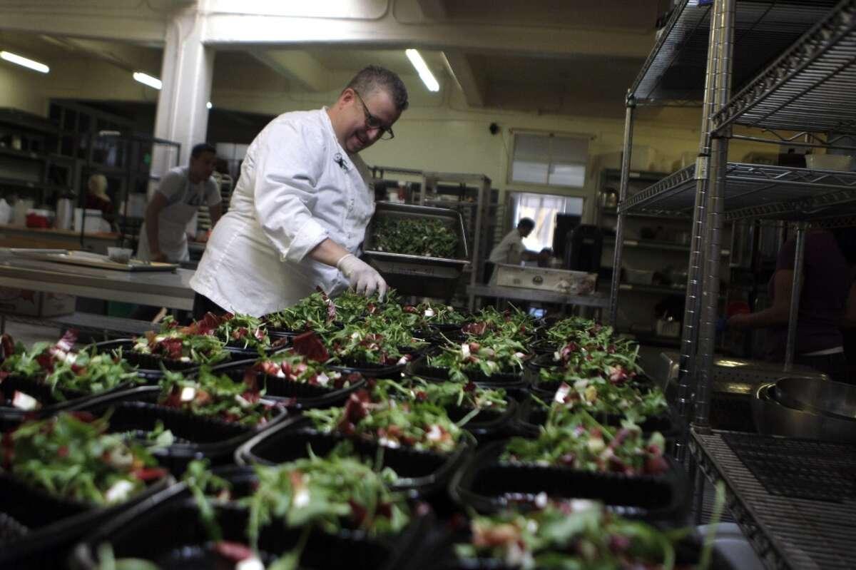 Steven Levine preparing his grilled hanger steak, smashed potatoes, and beet-feta salad at Munchery's kitchens.