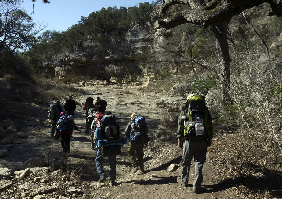 Hikers walk through Government Canyon State Natural Area, which has 40-plus miles of trails. Photo: John Davenport / San Antonio Express-News