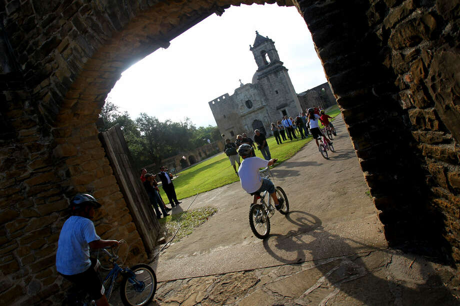 Cyclists enter the grounds of Mission San José. A variety of cycling groups exist around town, and trails are available at most parks in the San Antonio area. Photo: John Davenport / San Antonio Express-News