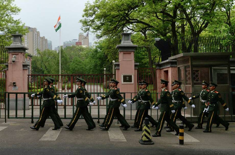 Chinese paramilitary police march past the gates of the Indian Embassy in Beijing on May 9. The world's two most populous countries reached a temporary resolution over a border flare-up that highlighted longstanding tensions. Photo: Mark Ralston / Getty Images