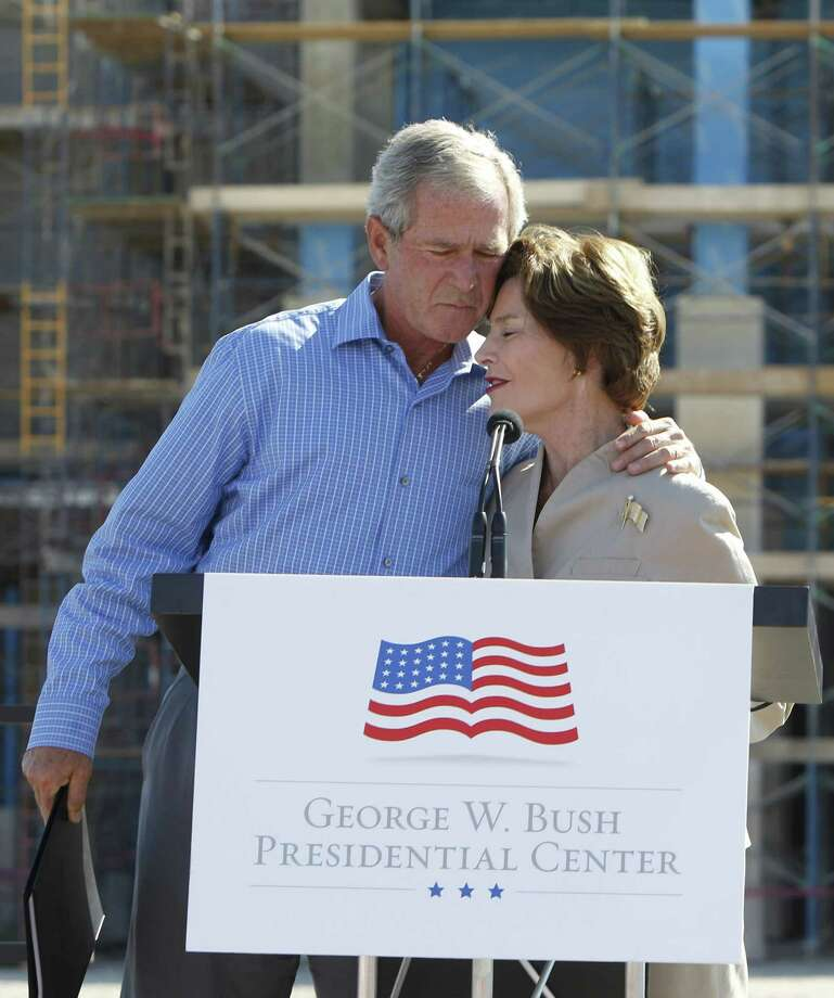 Former President George W. Bush and his wife, Laura, hug at a presidential library event in Dallas in October. A reader scorns a national columnist for her disparaging writing about Bush.