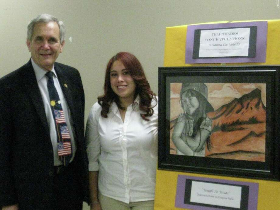 "U.S. Rep. Lloyd Doggett (left) and Brackenridge senior Arriana Castaneda with her painting, ""As Tough As Texas."" Photo: Jeremy T. Gerlach / Southside Reporter"