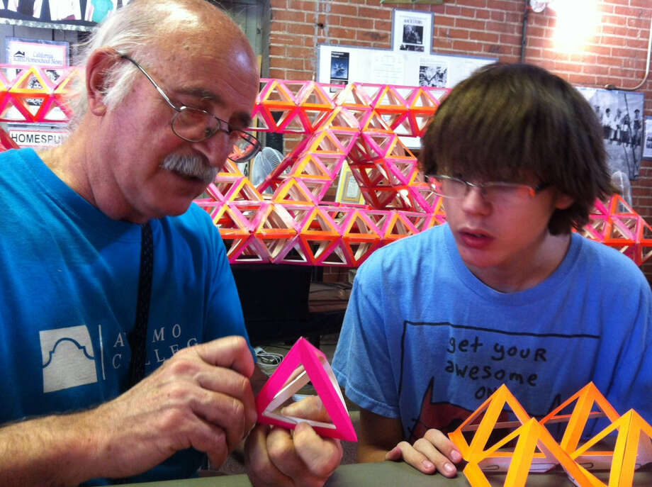 Dan Suttin (left) and ninth-grader Aaron Pfitzenmaier build with Octa-Tetra units.