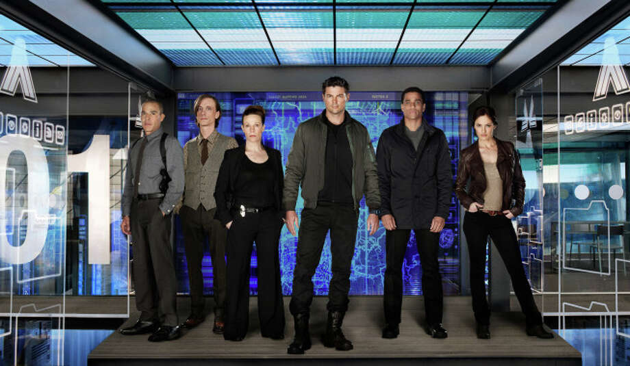 ALMOST HUMAN: Executive-produced by Emmy Award winner J.J. Abrams and creator J.H. Wyman and starring Karl Urban (C), Michael Ealy (second from R) and Emmy Award nominee Lili Taylor (R), ALMOST HUMAN is a high-tech, high-stakes action drama set 35 years in the future, when police officers are partnered with highly evolved human-like androids. An unlikely partnership is forged when a part-machine cop (Urban) is forced to pair with a part-human robot (Ealy) as they fight crime and investigate a deeper cover-up in a futuristic new world.  ALMOST HUMAN, the high-tech, high-stakes action drama premieres late fall on FOX.  Also pictured L-R: Michael Irby, Mackenzie Crook and Minka Kelly. ©2013 Fox Broadcasting Co. Cr: Kharen Hill/FOX