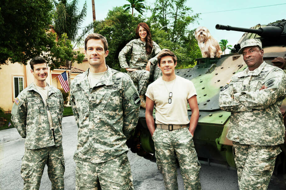 ENLISTED: Starring Geoff Stults (second from L), Chris Lowell (second from R) and Parker Young (L), ENLISTED is an irreverent and heartfelt single-camera comedy about an older sibling who returns home to reconnect with his two brothers and lead a group of misfits on a small Florida Army base. The irreverent and heartfelt single-camera comedy ENLISTED premieres late fall on FOX.  Also pictured: Angelique Cabral (C) and Keith David (R). ©2013 Fox Broadcasting Co.  Cr:  Patrick Ecclesine/FOX