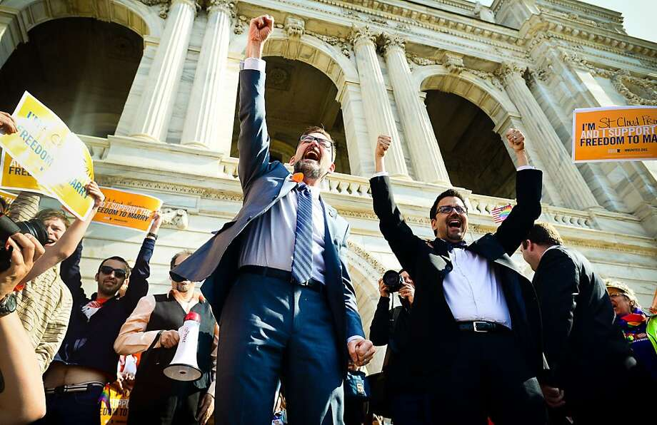 State Sen. Scott Dibble, D-Minneapolis, left, sponsor of Minnesota's same-sex marriage bill, and his partner, Richard Leyva, greet a crowd at the state Capitol before the vote. Photo: Ben Garvin, Associated Press