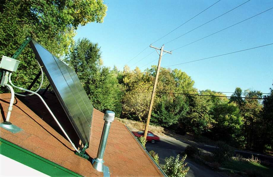 Purchase a rooftop photo-voltaic solar system. Photo: MOLLY VAN WAGNER, KRT / COLORADO SPRINGS GAZETTE