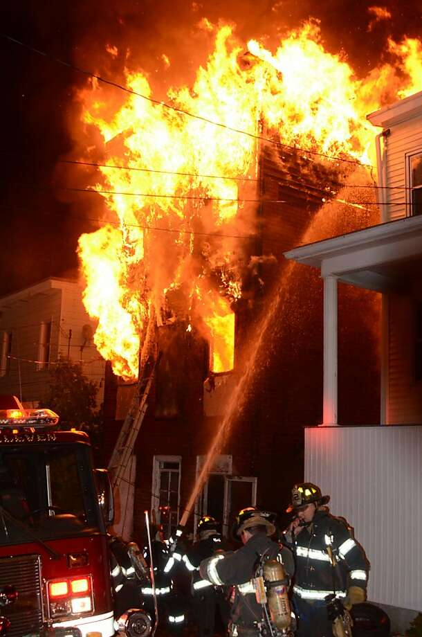 Firefighters battle an early-morning house fire that started late Sunday night in Pottsville, Pa. Photo: JC Kriesher, Associated Press